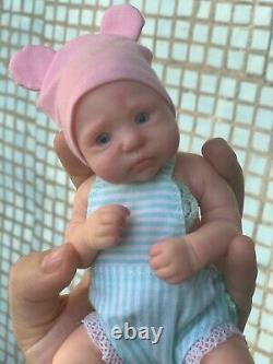 Reborn doll made of silicone. Mini baby newborn